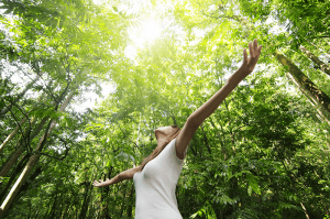 Happy, relaxed woman in the woods
