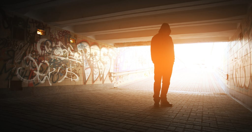 Man standing in tunnel. CBD for addiction treatment.