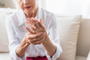 Elderly woman with arthritis