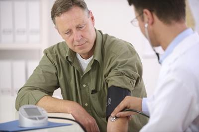 Doctor Measuring Blood Pressure on Man